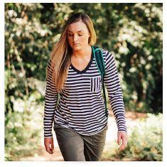 woman wearing striped long-sleeve shirt