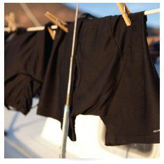 shorts drying on clothes line on boat