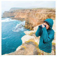 woman wearing hooded blue parka