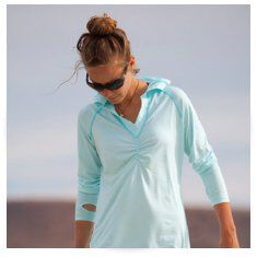 woman wearing long pullover top